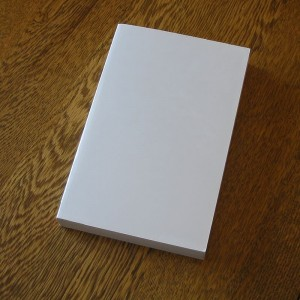 Blank_book_on_a_table
